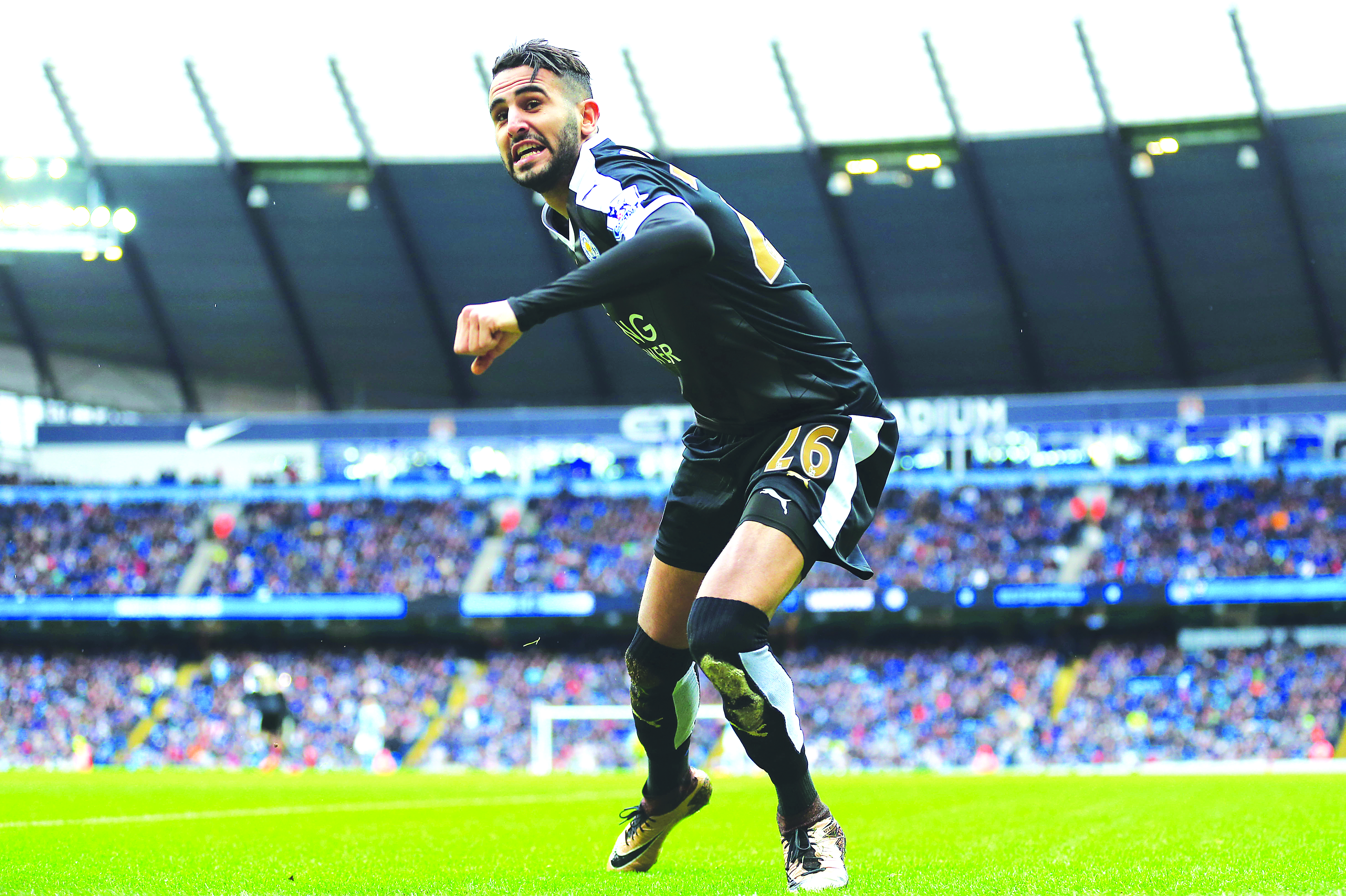 Leicester City's Riyad Mahrez celebrates scoring his side's second goal of the game during the Barclays Premier League match at the Etihad Stadium, Manchester.