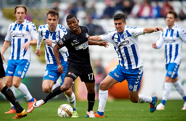 ODENSE, DENMARK - APRIL 03: Mandla Masango of Randers FC and Mohamed El Makrini of OB Odense compete for the ball during the Danish Alka Superliga match between OB Odense and Randers FC at TreFor Park on April 3, 2016 in Odense, Denmark. (Photo by Lars Ronbog / FrontZoneSport via Getty Images)
